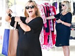 Back in black: But pregnant Reese Witherspoon seems ready for a change as her due date approaches
