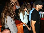 Make way for that bump! Gisele Bundchen and Tom Brady attend a charity bowling event in Boston