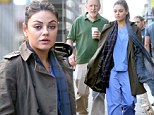 Scrubbing up well! Mila Kunis still manages to look good in hospital overalls