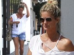 Showing the young ones how it's done: Rachel Hunter puts her enviable model legs on display in a pair of denim shorts