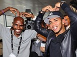 Strike a pose: Hamilton posed for pictures with Team GB hero Mo Farah at a charity event on Tuesday