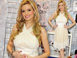 A dream in cream lace! Pregnant Holly Madison cradles her growing baby bump as she promotes new pet line