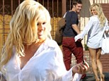 She's still got it! Pamela Anderson shows off her pins after as she goes to dance practice in blouse... and little else