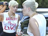 Peek-a-boob! Miley Cyrus continues her run of racy outfits and goes bra-less in revealing Sex Pistols T-shirt