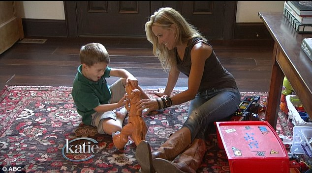 Play time: The Always on Your Side singer plays dinosaurs with her eldest son Wyatt, five