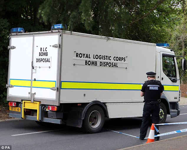Neighbours living close to the property in the affluent village of Claygate were prevented from returning to their houses as detectives examined the house for clues