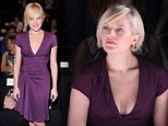 Can't take her eyes off the catwalk! Mad Men star Elisabeth Moss looks engrossed at Fashion Week wearing a low-cut dress