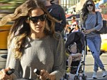Doting mom: Sarah Jessica Parker walked her twins Tabitha and Marion to school in downtown Manhattan on Tuesday morning