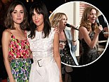 From rival Bridesmaids to best friends: Rose Byrne, left, and Kristen Wiig, right, pose together at the Marc Jacobs Spring 2013 Mercedes-Benz Fashion Week after-party at the New York Yacht Club on Monday night
