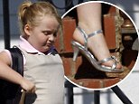 Off to school: Honey Boo Boo headed left her home in McIntrye, Georgia, yesterday wearing a uniform and sparkly heels