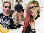 Newly-engaged: Avril Lavigne, at her New York Fashion Week catwalk show yesterday, is engaged to Nickelback frontman Chad Kroeger
