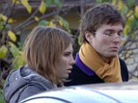 Innocent: U.S. citizen Amanda Knox, left, and her then-boyfriend Raffaele Sollecito, of Italy, outside the rented house where 21-year-old British student Meredith Kercher was found dead (file photo)