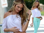 Model looks: Candice Swanepoel poses during a photoshoot for Victoria's Secret in Miami on Tuesday