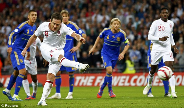 Spot on: Frank Lampard rescued a point for England with his penalty