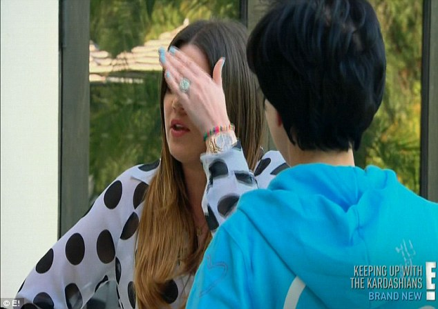 'Put them away, mom!' Khloe cringes as her mother tries to flaunt the breast operation