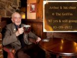 Arthur in his favourite chair that now has a plaque on to honour him