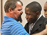 Drunk driver Takuna Mavima is embraced by Tim See, the father of one of the two teenagers that Mavima killed in a car accident shortly after his high school graduation in May