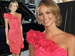 In full bloom: Stacy Keibler stuns in a hot pink form fitting one shoulder dress as she attends New York fashion show