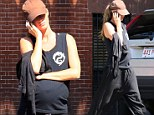 Keeping zen! Gisele Bunchen displays her VERY burgeoning baby bump as she heads home from a relaxing Tai Chi class