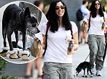 Sarah Silverman's embarrassed dog Duck tries to rip off his mini-Uggs