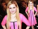 She's electric! Abigail Breslin backstage at Nanette Lepore before the designer's Spring 2013 show at Mercedes-Benz Fashion Week in New York City