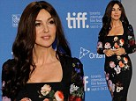 Bellissimo! Monica Bellucci looks bloomin' lovely as she shows off her killer curves in a floral print dress