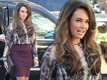 I'm ready for my close up! Tamara Ecclestone wears tight red skirt and sports big hair at New York Fashion Week