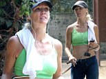 Jennie Garth, 40, shows off her washboard abs in crop top for morning run... as friends insist she's 'happier than ever' post divorce