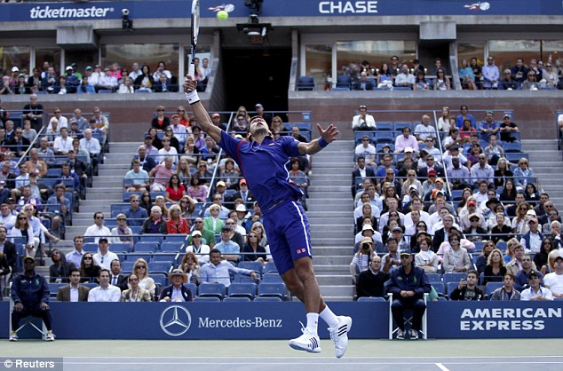 Reaching for the top: At times Djokovic seemed out on his feet but he kept on fighting for each point
