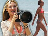 She's picture perfect! Bikini girl Candice Swanepoel gets behind the camera for a change as she takes charge on photoshoot