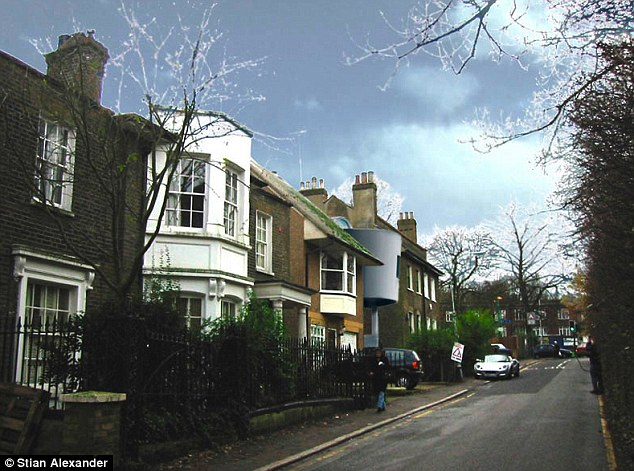 Leafy: Four-bedroom houses on Wood Lane regularly fetch asking prices of £3.5m