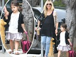 Eager to learn! Sarah Michelle Gellar's daughter Charlotte holds her pregnant mother's hand as she wheels her backpack to preschool