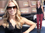 Sheryl Crow shows off her toned arms as she lugs boxes at charity event