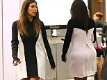 Optical disillusion! Kim Kardashian makes another fashion misstep in baggy monochrome dress
