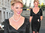 Katherine Heigl shows off her considerable assets in a VERY low cut dress as she attends charity event
