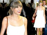 Taylor Swift puts on a brave face in a cute white sundress as she lands in Rio after emotional performance