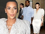 It's Big Bird! Kim Kardashian takes Kanye's fashion advice to new heights as she wears white fringed gown to Marchesa show