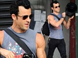 So that's what Jennifer sees in him! Justin Theroux shows off his bulging biceps in sleeveless vest
