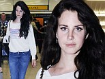 She's worlds away from that GQ shoot! Lana Del Rey looks pale and grey as she jets out of London make-up free