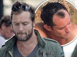 Not even Sherlock Holmes could work that one out! Jude Law sports MUCH fuller head of hair