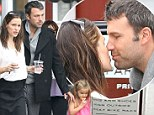 Picture perfect family! Jennifer Garner and Ben Affleck share a loving kiss as they take daughter Seraphina out for breakfast