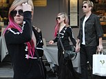 Is Avril Lavigne pregnant? Newly engaged singer appears to have a 'baby bump' as she cavorts around Paris with fiancé