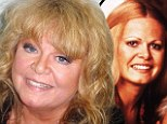 Mug shot: Sally Struthers smiled for the police following her arrest yesterday