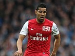 Charged: Arsenal defender Andre Santos