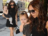 Victoria Beckham gives a lesson in how to coordinate as she matches her handbag to baby Harper's romper