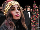 Lady Gaga dons bizarre floral hooded robe at her perfume launch party