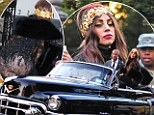 Not quite a Lady! Gaga flashes her behind in transparent dress as she exits her convertible Cadillac