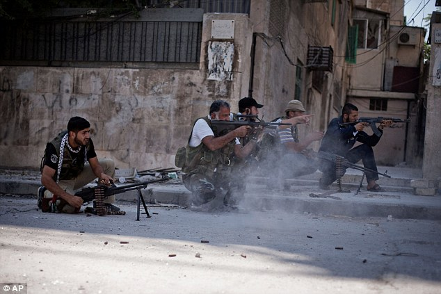 Gun battle: Free Syrian Army soldiers shoot at Syrian Army officers in the Izaa district of Aleppo, Syria
