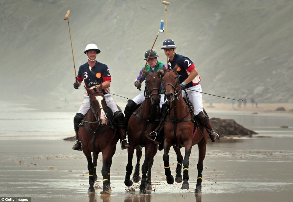 (L-R) Rob Brockett, Andy Burgess and Major Ben Marshall prepare for the beach tournament