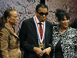 One of a kind: Ali's family, including his wife Lonnie (second left) and sister-in-law Marilyn Williams (right) said the icon received the award despite 'standing up for what he believes in'